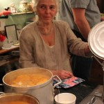 Rita, my mom, the one who makes this all happen. Shown here checking on the  Bouillabaisse.
