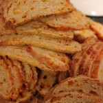 Gail's famous cheese bread, sliced thin and ready for toasting.