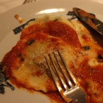 """First course: ravioli with the """"best sauce ever."""" It has pureed bacon in it. I had a veggie version."""